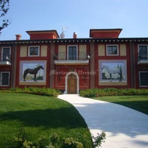 Fresco horses painted on an external façade