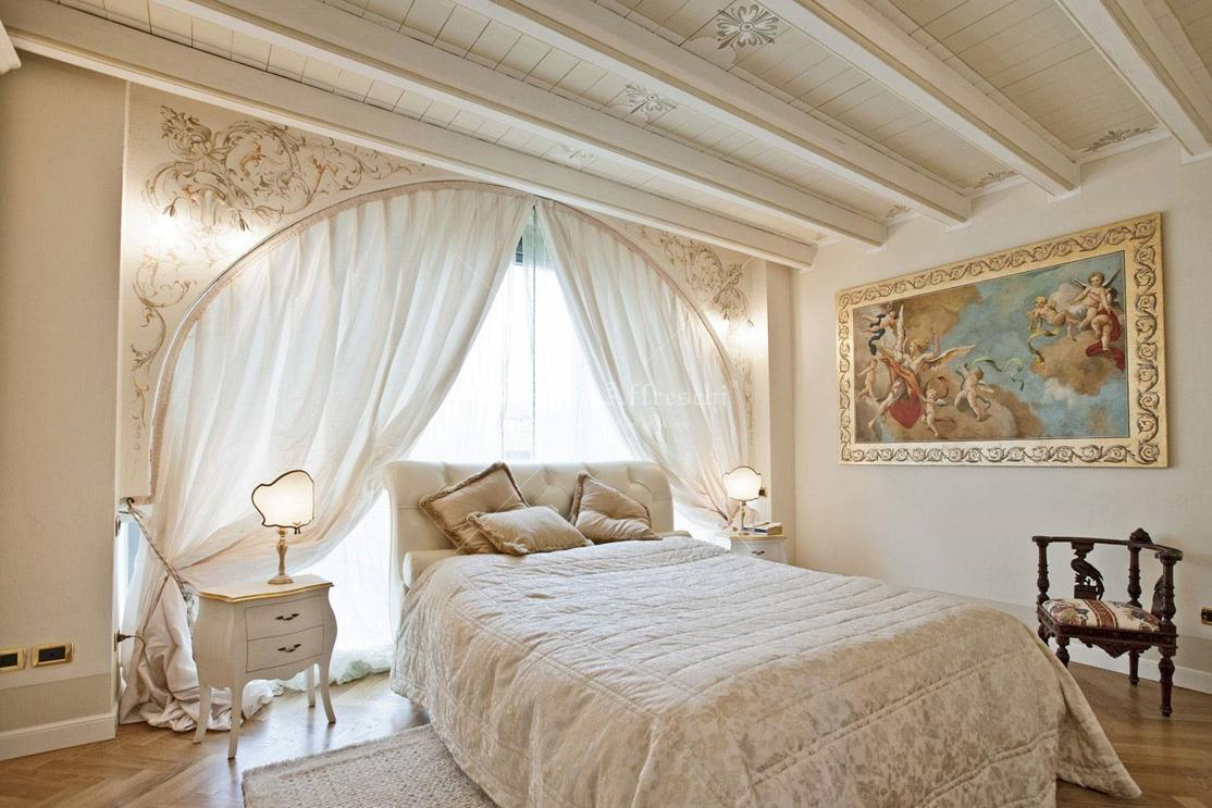 Bedroom decorated with classic fresco fixed on a frame, wall and ...