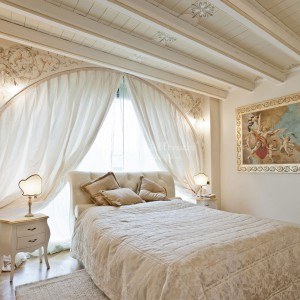 Bedroom decorated with classic fresco fixed on a frame, wall and ceiling decorations