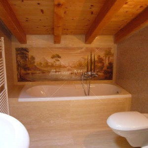 Fresco with lake landscape painted on top of a bathtub