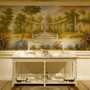 "Fresco landscape inserted in picture-frame wainscoting. ""Tessitura e Confezioni Rapetti"" showroom of Cassolnovo in Pavia"