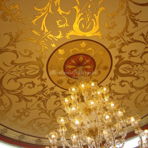 Rosette with gold leaf decorations painted on a dome. Private villa in Dubai