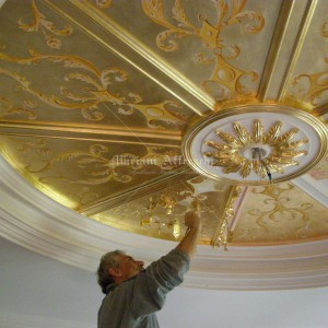 Ceiling decorated with friezes and gold leaf background